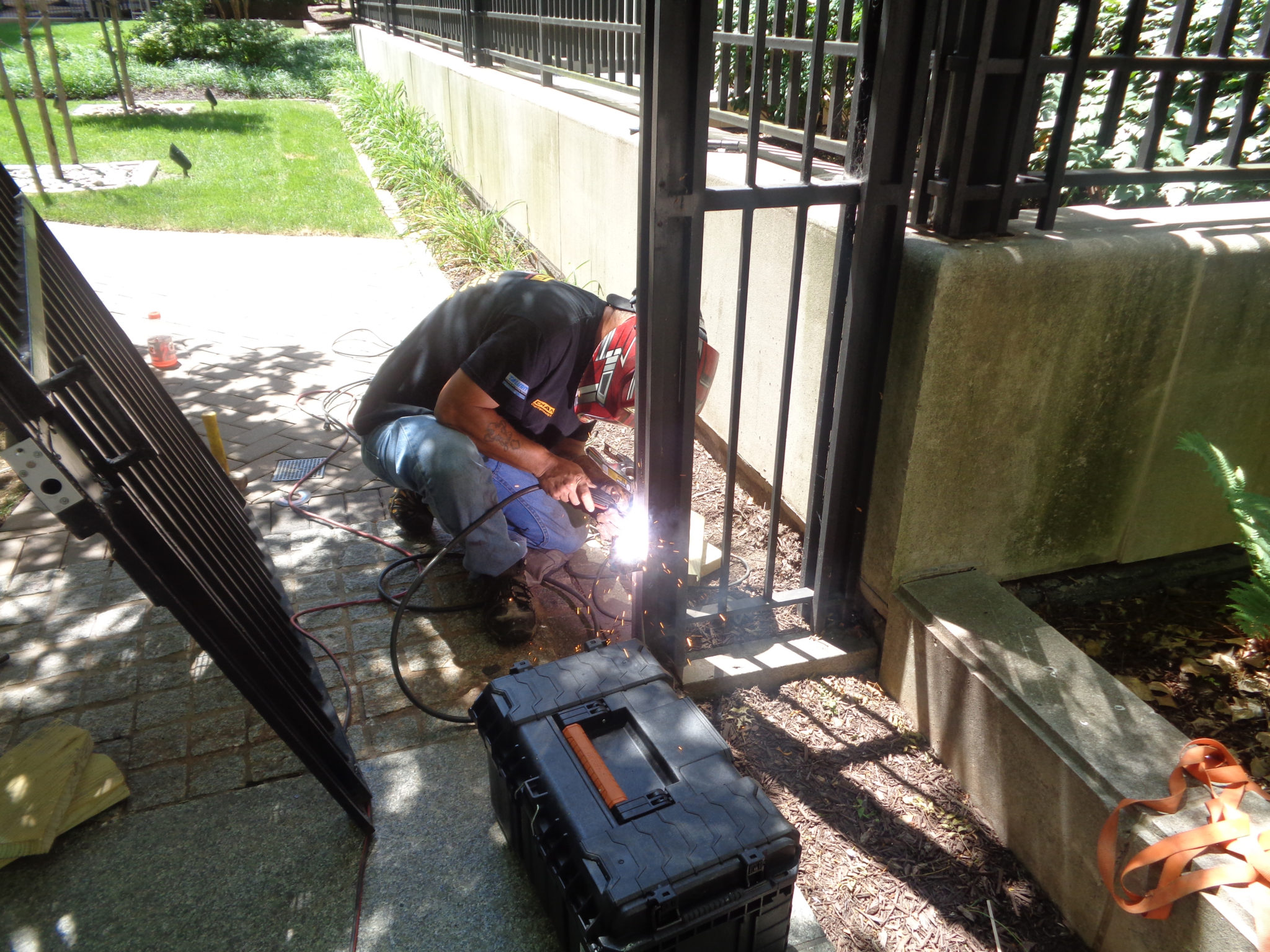 welding-a-security-gate-iron-fence-toronto-contractor